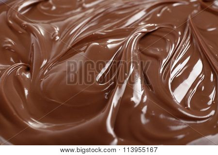 Background of melted milk chocolate, close-up