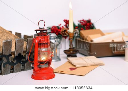 Christmas concept. Chest with wish lists and lamp on the table, close up