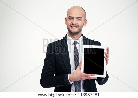 Attractive happy young business man holding blank screen tablet over white background