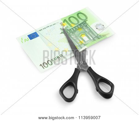Scissors cut euro banknote, isolated on white