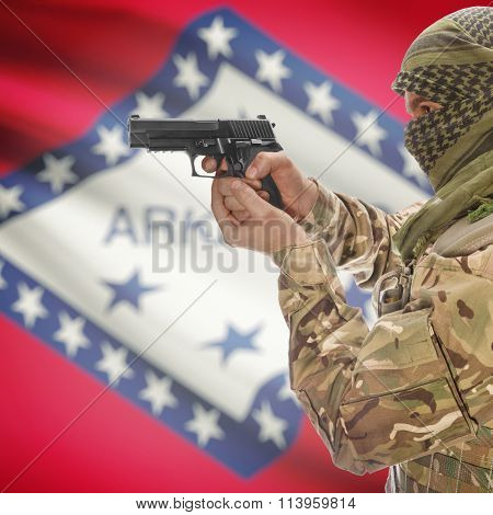 Male In With Gun In Hand And Flag On Background - Arkansas