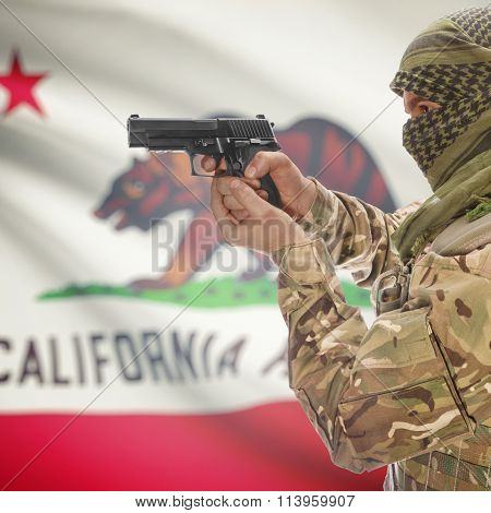 Male In With Gun In Hand And Flag On Background - California