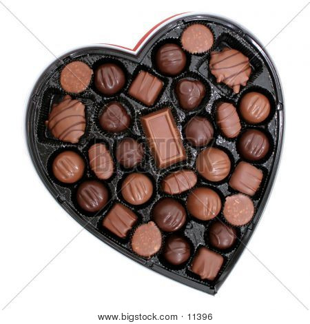 Heart shaped box of dark and light assorted chocolates.
