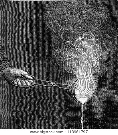 Combustion of the zinc in a crucible, vintage engraved illustration. Magasin Pittoresque 1870.