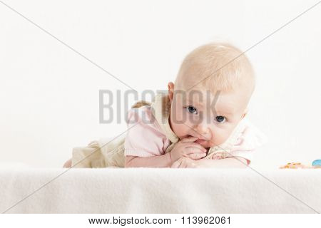 portrait of lying four months old baby girl