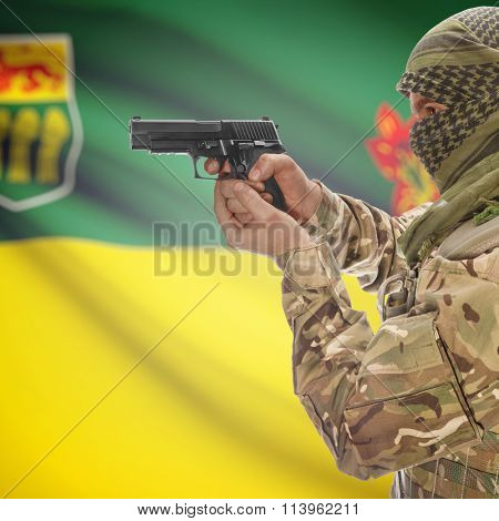 Male In With Gun In Hand And Canadian Province Flag On Background - Saskatchewan