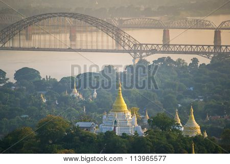 The bridge across Irrawadee river and the old pagodas in Sagaing Area.