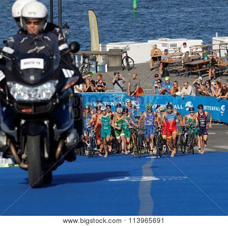 Large Group Of Triathletes Running In The Transition Zone