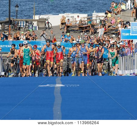 STOCKHOLM SWEDEN - AUG 23 2015: Large group of triathletes running uphill in the transition zone from cycling to running in the Men's ITU World Triathlon series event August 23 2015 in Stockholm Sweden