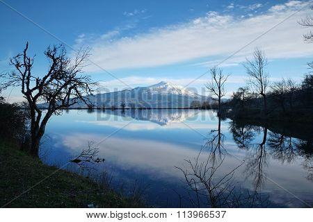 Etna volcano reflection in a pond of Nebrodi Park, Sicily