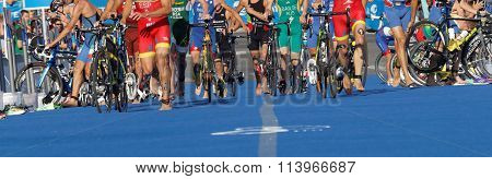 Cycle Wheels, Running Feet Of Colorful Triathletes