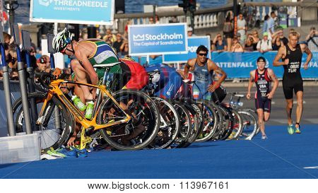Triathletes Parking Cycles And Changing Shoes In The Transition Zone