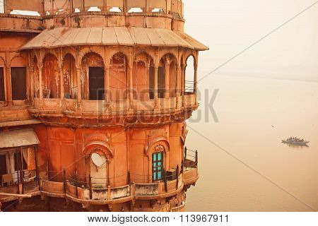 Tower View On Sacred Waters Of River Ganges In Historical Indian City
