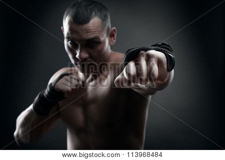 Fighter boxer and warrior's fist on black background