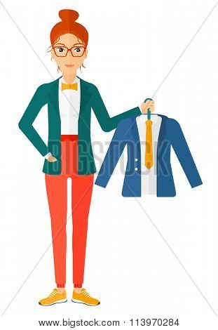 Woman holding jacket.