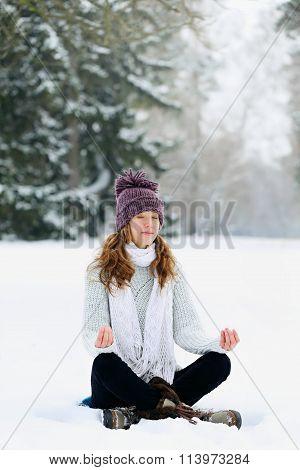 woman meditating at the park