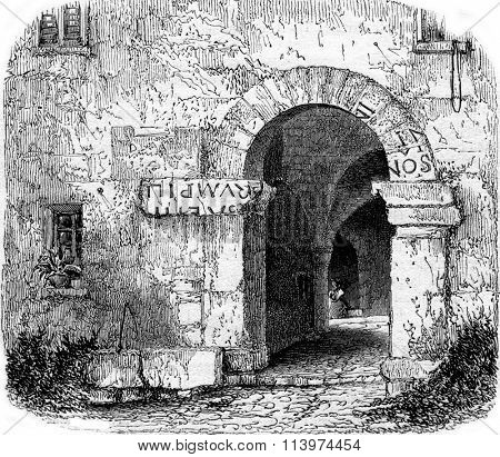 Fragments of the registration of Augustus on the door of a house in La Turbie, vintage engraved illustration. Magasin Pittoresque 1853.