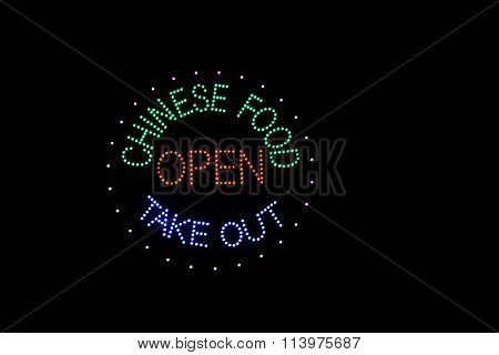 A bright neon sign showing chinese food