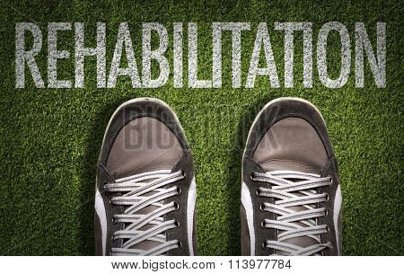 Top View of Sneakers on the grass with the text: Rehabilitation
