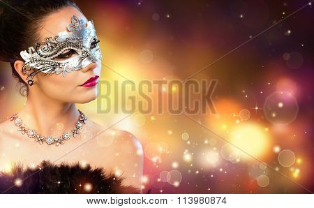 Elegance Woman Wearing Carnival Mask With Golden Stardust