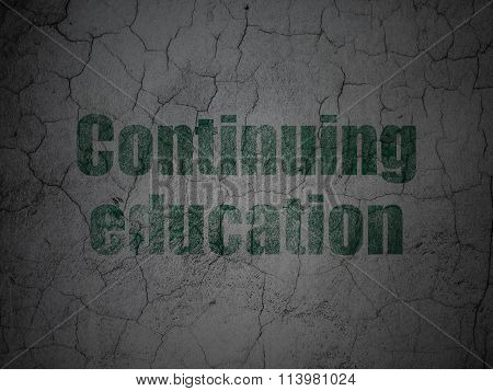 Learning concept: Continuing Education on grunge wall background