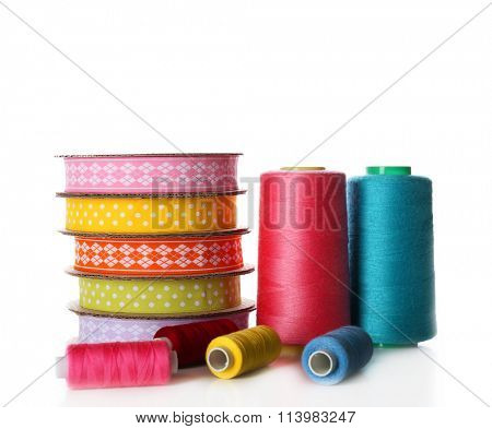 Spools of color ribbon and thread, isolated on white