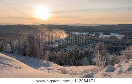 Sunset Over Winter Forest