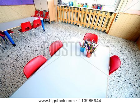 Classroom Of Kindergarten With Desks And Small Chairs