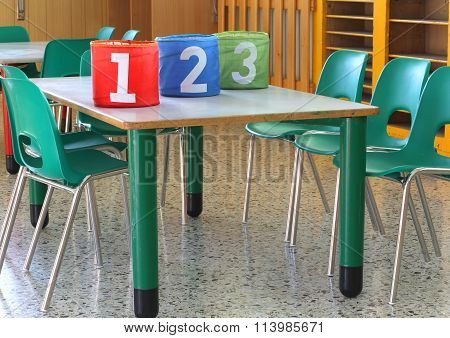 Cans With Large Numbers In Kindergarten