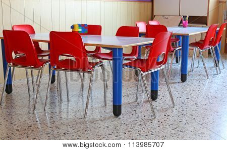 Classroom Of A Kindergarten With Chairs And School Desks