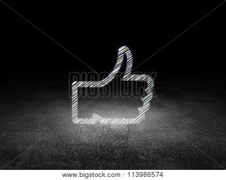 Social media concept: Thumb Up in grunge dark room