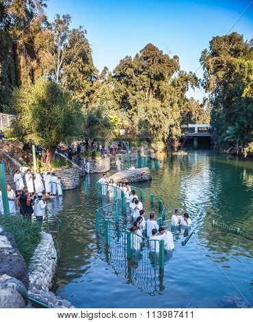 YARDENIT, ISRAEL - JANUARY 21, 2012: Christian pilgrims enter Jordan River waters. Christian pilgrims make here baptized in honor of the baptism of Jesus Christ