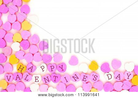 Happy Valentines Day candy hearts corner border over white