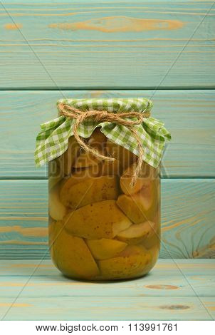 One Jar Of Pear Compote At Blue Vintage Wood Surface