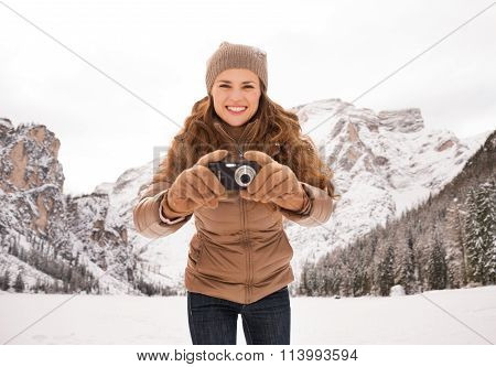 Woman With Compact Camera Outdoors Among Snow-capped Mountains