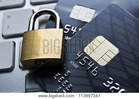 lock is on credit card and keyboard / credit card data encryption security