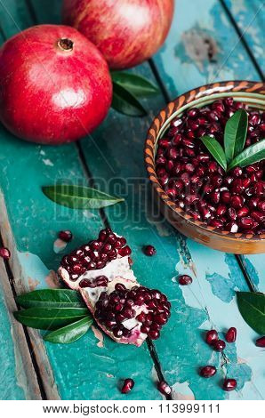 A Bowl Of Pomegranate Seeds On The Old Wooden Background. Rustic Still Life.