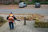 pic of leaf-blower  - worker with professional fuel powered leave blower - JPG