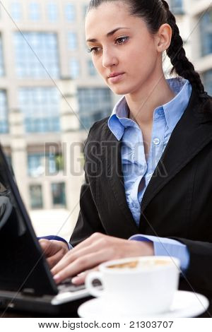 Business Woman Working In Internet Cafe