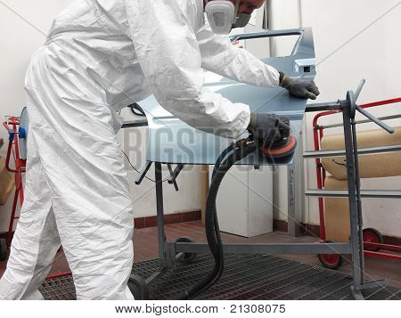 Painter With A Grinding Machine