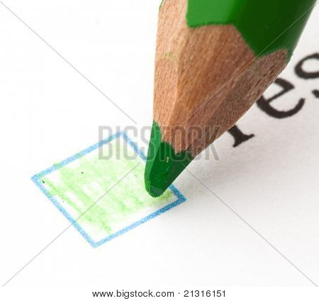 questionnaire check boxes and green pencil, closeup