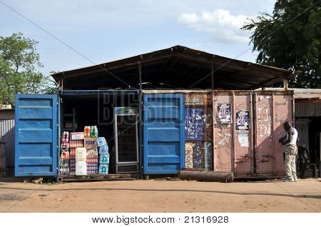 JUBA â?? JUNE 10: Unidentified men standing in front of containers turned into a shop in Juba, capital of South Sudan, on June 10, 2011. Containers are used in Juba for everything from shops to hotels.