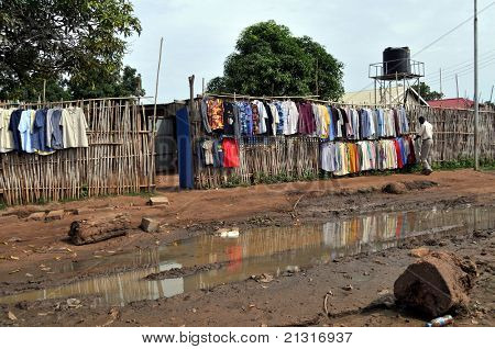 JUBA – JUNE 11: An unidentified man arranges shirts for sale at a clothing store on a downtown street in Juba, South Sudan, on June 11, 2011. South Sudan is one of the most undeveloped countries.