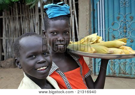 TEREKEKA â?? JUNE 11: Unidentified children selling cooked corn in Terekeka, South Sudan, on June 11, 2011. World Day Against Child Labour, launched by ILO, was observed on June 12, 2011.