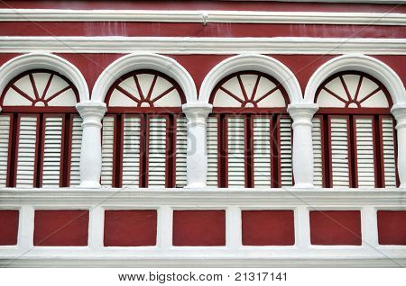 Closeup of the red facade of a colonial house in Willemstad, the capital of Curacao, in the Caribbean. Downtown Willemstad is a UNESCO World Heritage Site.