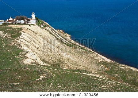 Old White Lighthouse On Sea Coast