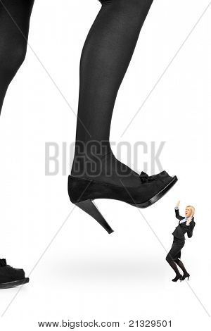 Big woman shoe stepping on a businesswoman isolated on white background