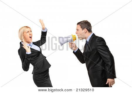 Angry businessman yelling via megaphone to a businesswoman isolated on white background