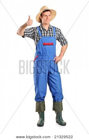 A young smiling farmer giving a thumb up isolated on white background