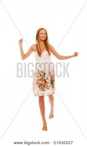 A full-length portrait of a pretty young girl wearing a nice summer dress, isolated on white